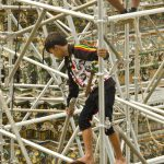 Boy in Flips Flops on Scaffolding