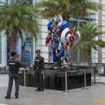 Police pose with Transformers Staue